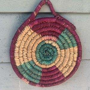 Coiled colorful boho decor or basket wall accent
